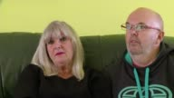Ryanair's Michael O'Leary apologises for cancelled flights ENGLAND INT Karen and Roger Willis interview SOT Various of Willis family on sofa with...