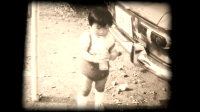 60's 8mm footage - young boy drinking with straw
