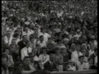 B/W 1960's audience clapping in crowded stadium / West Berlin