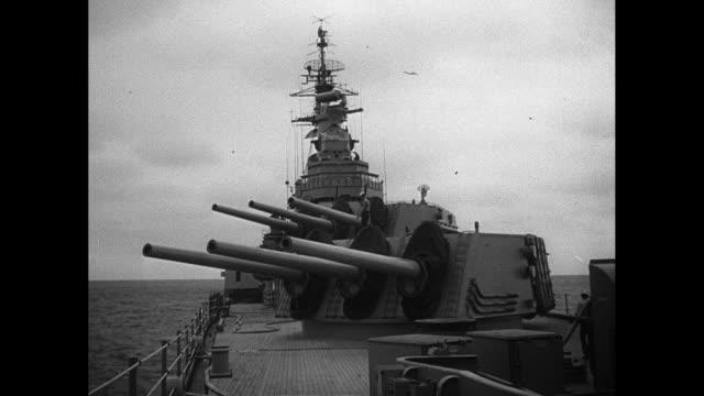 1940's Battleship With Gun Turrets Rotating and Aiming Up