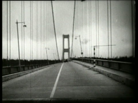 B/W 1940's bridge twisting swaying buckling in wind / Galloping Gertie / Tacoma Narrows Bridge /
