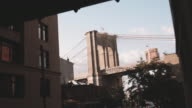 NYC's Brooklyn Bridge looming in the shadows