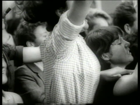 B/W 1960's close up of cheering screaming teenagers in concert crowd / Beatles / Holland
