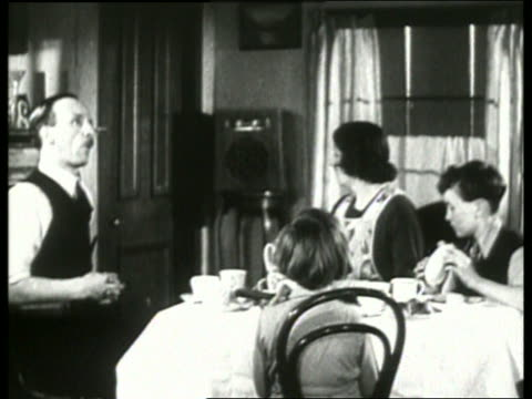 B/W 1930's family at dinner table listening to radio / NO SOUND