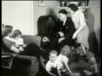 B/W 1930's family listening to radio in living room / NO SOUND