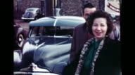 1940's - Guests gather outside church after wedding
