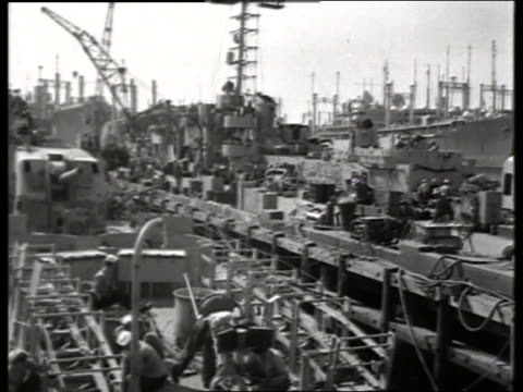 B/W 1950's military ships at dock / sailors and dock workers / NO