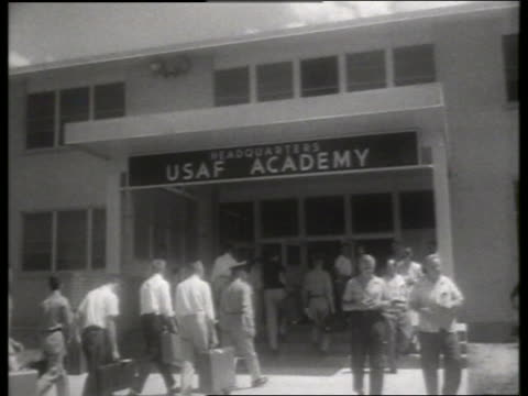 B/W 1950's soldiers and recruits walk into Air Force Academy / Lowry Air Force Base, Denver / SOUND