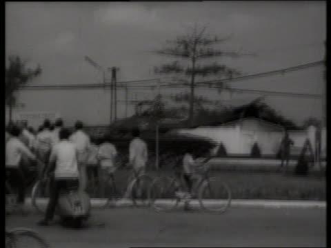 B/W 1960's tank driving past crowd of Vietnamese / Saigon / SOUND