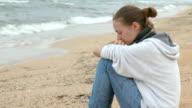 sad girl on the beach