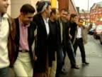Saddam Hussein capture Evening news Manchester DAY CMS Iraqi kurds dancing in the street to celebrate capture of Saddam PAN