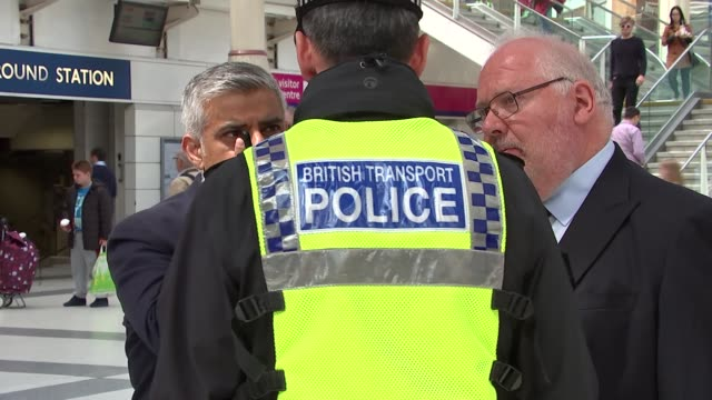 Sadiq Khan and Lord Harris at Liverpool Street Station Armed police officers on duty Sadiq Khan and Lord Harris touring station / Khan chatting to...