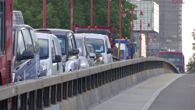 Sadiq Khan calls for more longterm antiterrorist barriers ENGLAND London EXT Bollards lowering into ground Cars on bridge with metal antiterrorist...