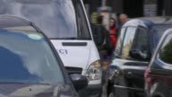 Sadiq Khan to make decision on Uber licence in London ENGLAND London EXT London taxi and cars along Various of cars with barcode sticker in...