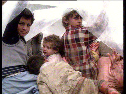 Uludere GV Kurds camp CMS Kurds under polythene shelter PULL MS Toddler crying as held up on muddy ground TCMS Kurd children
