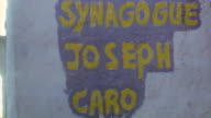 Safed alleyway / Sign for Synagogue Joseph Caro / Inside Sanctuary / Shot of Cats in Alley / Old Man Unlocking Door / Synagogue Joseph Caro on...