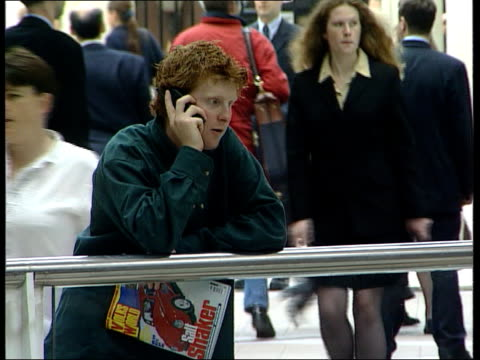 Safety checks LIB ENGLAND London Liverpool Street Station INT People using mobile phones Order Ref BSP220999023