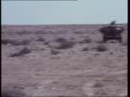 Sahara march MOROCCO Sahara Desert Sahara Desert Moroccan encampment very vaguely seen on horizon MS PAN more and troops MS Guns on two landrovers MS...