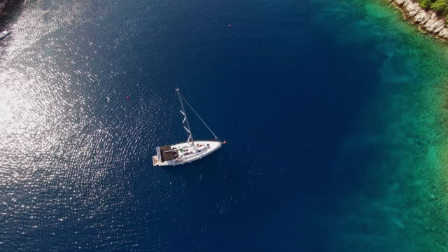 AERIAL Sailboat in a beautiful bay
