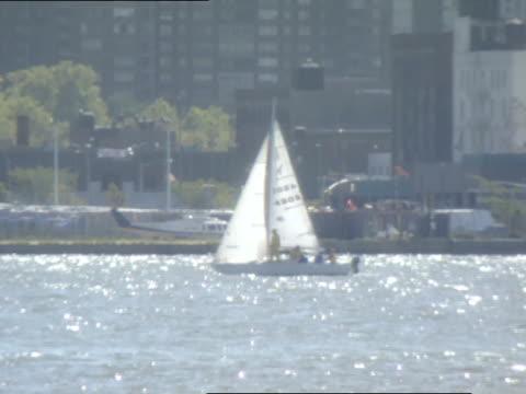 Sailboat in Hudson River PAN TU MS Midtown Manhattan buildings skyline ZI XWS New York City skyline CHANGES LENS several times