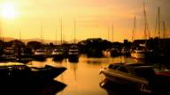 Sailboat on tropical sunset beach