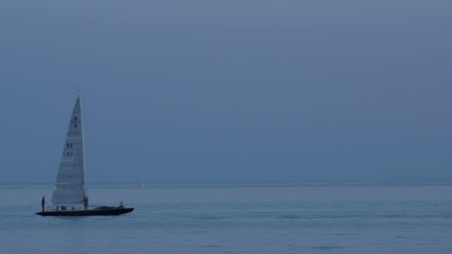Sailboating passing through shot