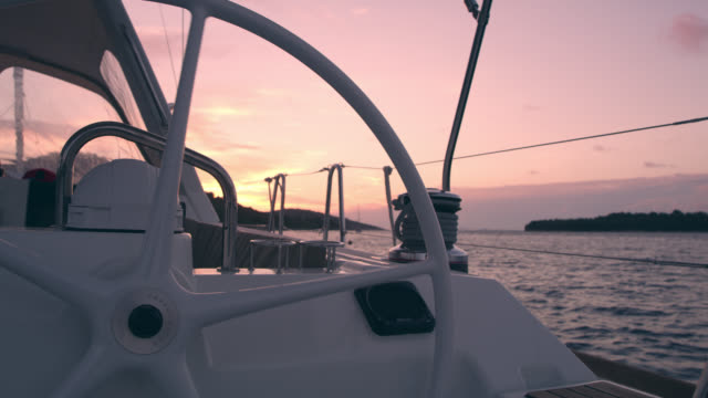 MS Sailboat's helm and winch at sunset