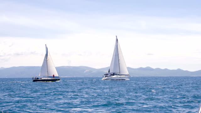 LS Sailboats Sailing Near The Coastline