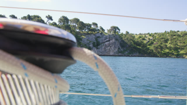 WS Sailing along rocky island's coast