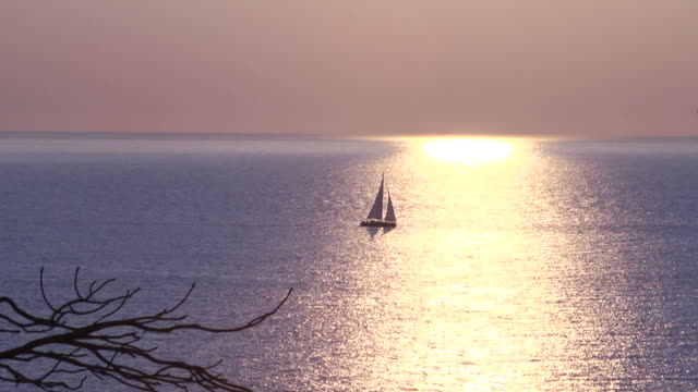 Sailing Boat during Sunrise