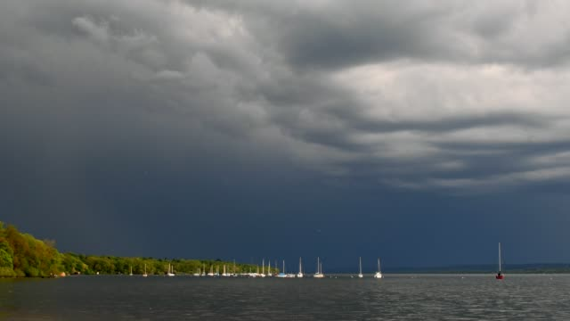 Sailing boats on lake with a rising thunderstorm, Inning Stegen, Fuenfseenland, Upper Bavaria, Bavaria, Germany