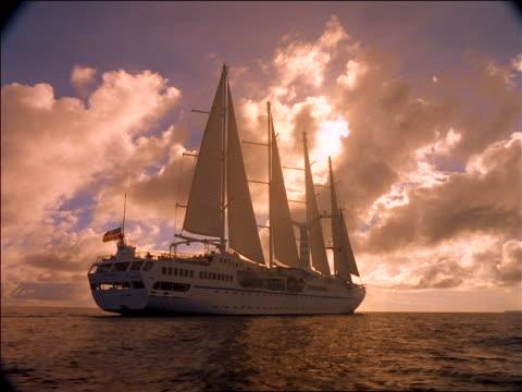 Sailing ship on ocean / Tahiti