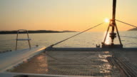 HD: Sailing With Catamaran At Sunset