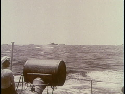 sailor looking through periscope / sailor dropping depth charge / depth charge exploding