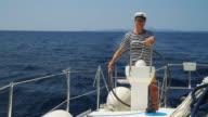 HD: Sailor Navigating A Sailboat