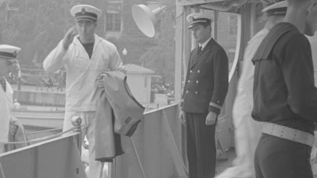 MS Sailors boarding in boat and salute senior