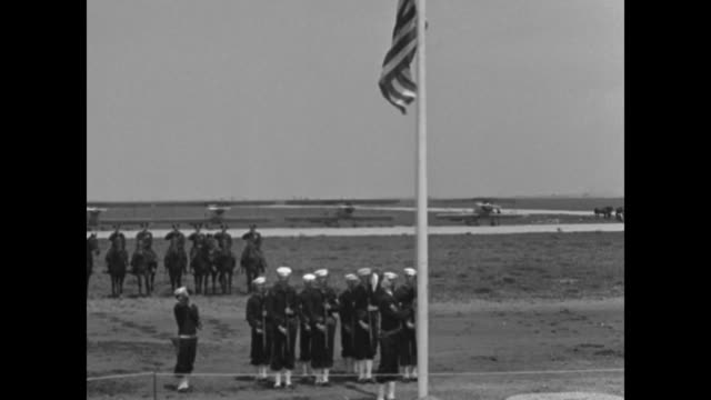 US sailors raise the US flag as mounted police stand in salute during the opening of Floyd Bennett Field in Brooklyn VO woman sings 'The Star...