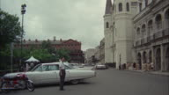 1967 WS TD PAN Saint Louis Cathedral and traffic on street / New Orleans, Louisiana, USA