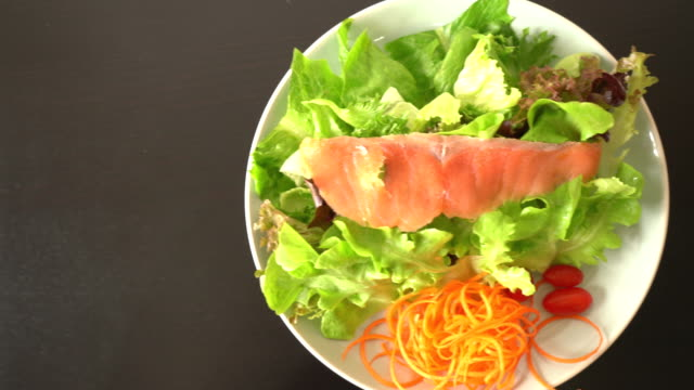 Salad - smoked salmon with vegetables - healthy food