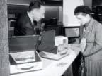 A salesman shows a customer a portable radio