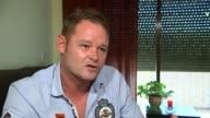 Wrongly convicted Romano Van Der Dussen interview LOCATION Romano Van Der Dussen interview SOT Hand holding book TILT UP Van Der Dussen Various of...