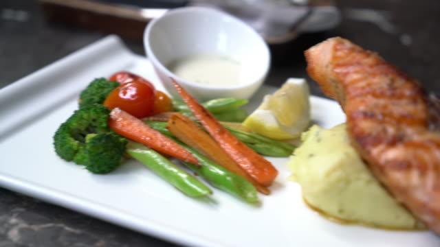 salmon steak with mash potato and vegetables