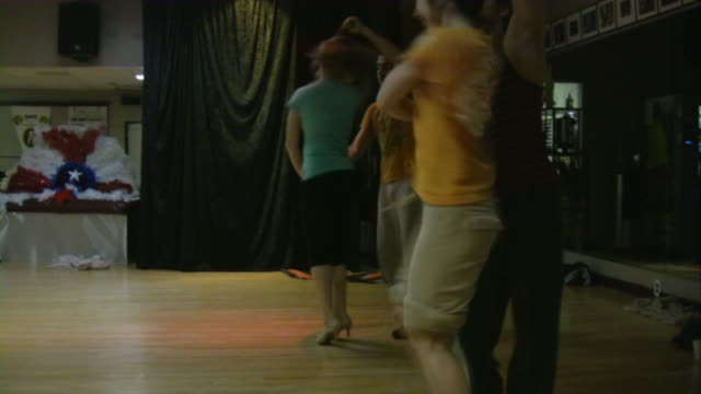 Salsa dancers practicing dancing in dance studio. South American rhythms.