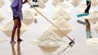 Salt harvesting, Thailand.