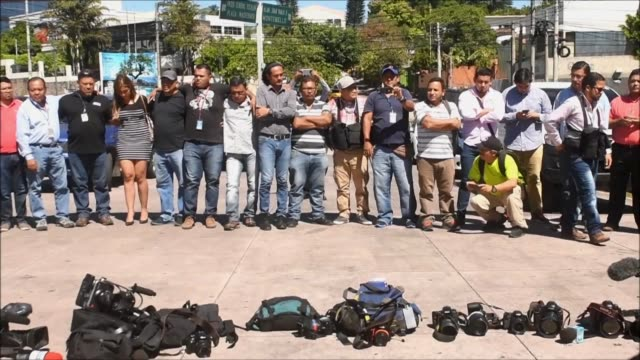 Salvadoran journalists place their cameras and microphones on the street to protest against violence and ask for justice for slain cameraman Samuel...