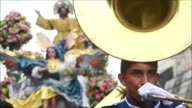 Salvadorian Catholics take part in a religious procession in honour of their patron saint Divino Salvador in the country's capital on Saturday