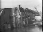 Salvage operation continues on the ship SS Normandie renamed the USS Lafayette / view of ship as it lay on it's side in New York Harbor / underside...