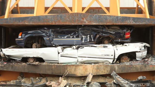 Salvage Yard Car Crusher Smashing Vehicle