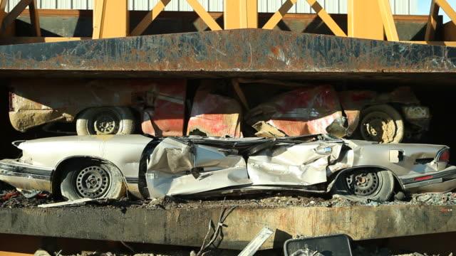 Salvage Yard Car Crusher Smashing Vehicles
