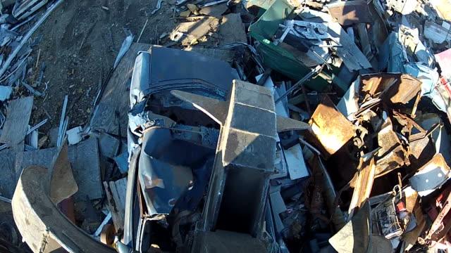 Salvage Yard Grappling Claw Releasing Scrap Car